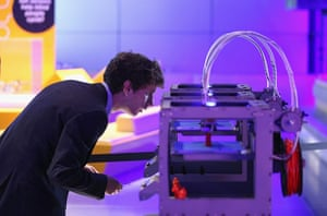 3d printing: A 3D printer as it constructs a model figurine