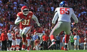 Tamba Hali rushes against offensive tackle Will Beatty, of the New York Giants