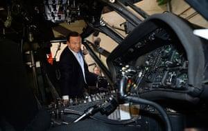 Putin and Abbott: Abbott inspects a Black Hawk helicopter