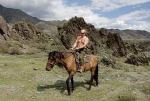 Putin and Abbott: Putin rides a horse bare-chested