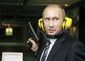 Putin and Abbott: Putin holding gun