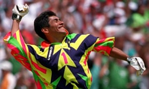 Jorge Campos tests the strength of spectators  sunglasses with his dazzling  disco outfit at USA  94. Photograph  Billy Stickland Getty Images b28962820