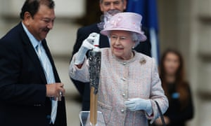 The Queen places a message for the host city inside the baton. The Commonwealth Games baton doesn't have a flame luckily.