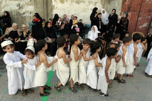 Palestinian children learn about rituals carried out during the annual Hajj pilgrimage, at their kindergarten in Rafah town, Gaza Strip.