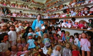 Dolls' house: Mary Hickey aged 93, poses with her collection of dolls at her home in Ashbourne, Ireland. Hickey has been collecting the dolls for over thirty years and now owns over 420 dolls.