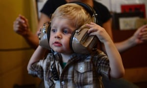 A toddler takes part in a Baby DJ School class, aimed at preschool children to learn the basics on how to mix music, in New York.