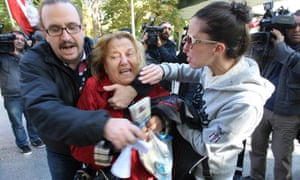 Relatives of army officers cry outside the appeals court in Ankara,Turkey, after the court upheld the convictions of scores of top retired military officers over a 2003 coup plot but overturned jail sentences handed to dozens of lower-ranking defendants.