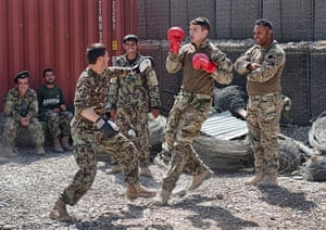 Army Photographic winners: Soldiers from 1SCOTS bonding with their Afghan brothers at one of the check