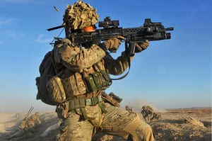 Army Photographic winners: Cpl Carl Hines Royal Artillery, provides covering fire while members of the