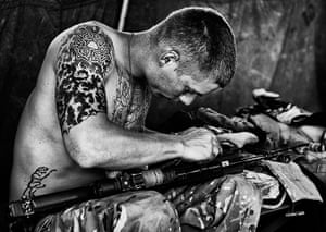 Army Photographic winners: Private Ross Cunningham from 1SCOTS cleaning his personal weapon at Forward