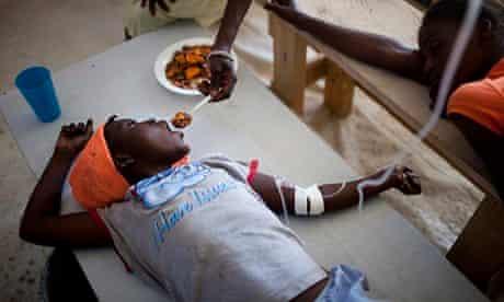 A young Haitian girl suffering from cholera