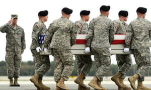 US army soldiers carry remains