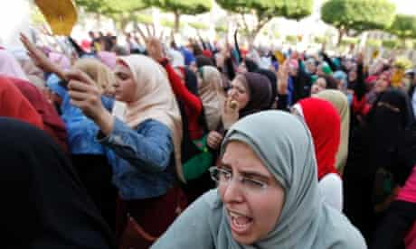 Cairo University students and members of the Muslim Brotherhood shout protest against the military.