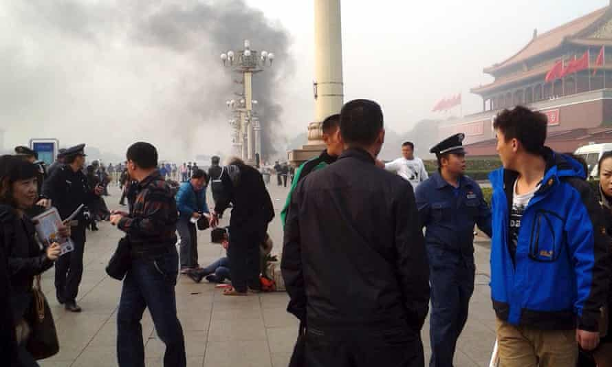 Smoke raises from the scene of the attack in Tiananmen Square.