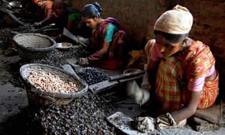 Indian women work at a cashew factory in Agartala