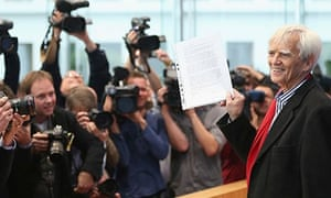 Hans-Christian Stroebele, member of the German Greens Party and the Bundestag, holds up a letter fro