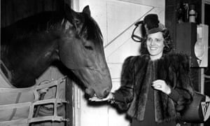 Seabiscuit gets a carrot from owner Mrs Charles Howard in Baltimore