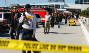 Passengers are evacuated after a shooting incident at Los Angeles airport.