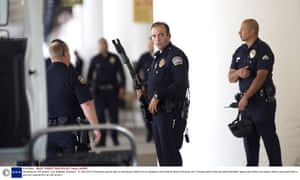 Police officers on guard after today's shooting incident at Los Angeles International Airport.
