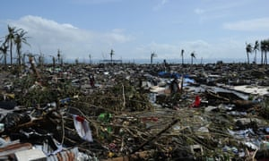 Flattened houses along the coastal area in Tacloban.  Photograph: Ted Aljibe/AFP/Getty Images
