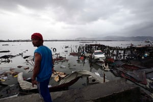 Typhoon hits Tacloban: a man looks at damaged structures