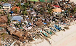 An aerial view of damaged houses in Iloilo, Philippines.