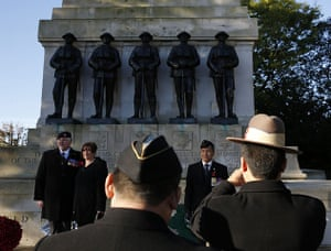 Remembrance Sunday: Ex-servicemen pose for photographs at the Guards Memorial in central London