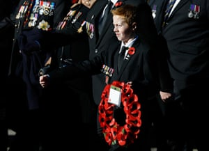 Remembrance Sunday: A young boy holds a wreath during the service of remembrance