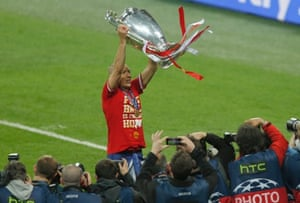 Bayern Munich's Arjen Robben is seen celebrating with the trophy after defeating Borussia Dortmund in their Champions League Final soccer match at Wembley Stadium in London in this May 25, 2013 file photograph.
