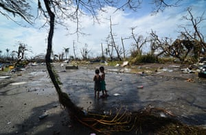 Tacloban survivors: Two young boys look at the devastation in the aftermath of typhoon Haiyan i