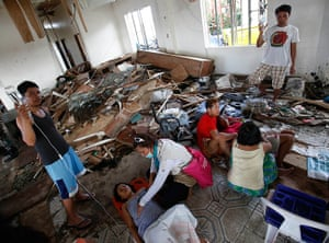 Tacloban survivors: A pregnant woman and a mother who has just given birth lie inside a makeshi