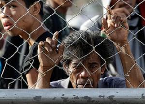 Tacloban survivors: Survivors queue up to receive treatment and relief supplies at Tacloban air