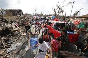 Tacloban survivors: Survivors fill the streets as they search for supplies