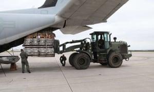 Marines load equipment onto a KC-130J Hercules