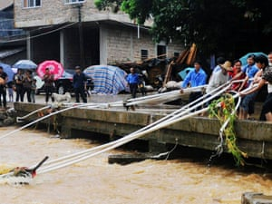 Residents salvage water pipes which were washed away by floods  on November 11, 2013 in Yong an, Bobai County,  Guangxi Zhuang, China.   Typhoon Haiyan, the 30th and strongest typhoon to hit China this year, arrived in the mid-south area of Guangxi and brought gales and rainstorms.