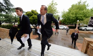 Lukas Coch captured Tony Abbott mid-flight as he arrived early this morning at the ecumenical service at St. Christopher's Cathedral in Canberra. Opposition leader Bill Shorten joined him.