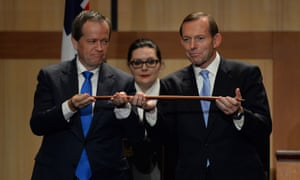 Whimsy before hostilities: Tony Abbott and Opposition Leader Bill Shorten hold a boomerang as they attend the Welcome to Country ceremony at Parliament. (AAP Image for The Guardian/Lukas Coch)