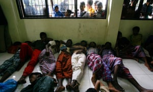 Rohingya refugees sleep on the floor of the immigration office in Lhok Seumawe, Indonesia, after being rescued by a fisherman. They were stranded at sea while heading for Australia.