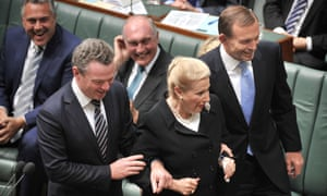 Bronwyn Bishop is escorted to the speaker's chair by Christopher Pyne, left, and Tony Abbott.