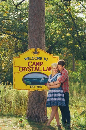 Big Picture - Friday 13th: couple hugging in front of sign