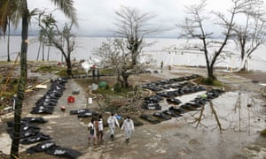 Bodies of the victims of Typhoon Haiyan are placed on an empty place in Tacloban.