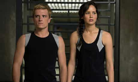 Jennifer Lawrence with Josh Hutcheson in The Hunger Games