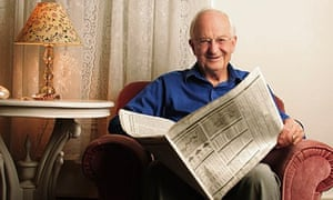 Older man in armchair with newspaper