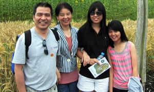 Jeff Ding with his wife, Helen, and daughters Nancy and Alice, who were murdered om their home
