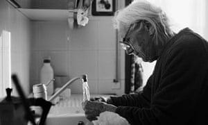 Older woman washing up