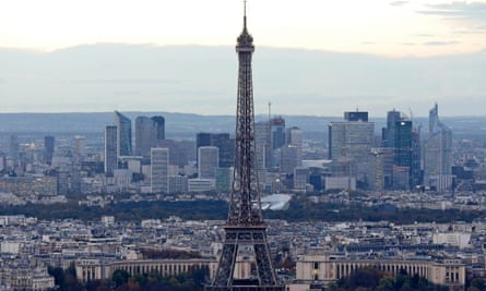 A general view shows the Eiffel Tower and La Defense business district (background) in Paris November 8, 2013.