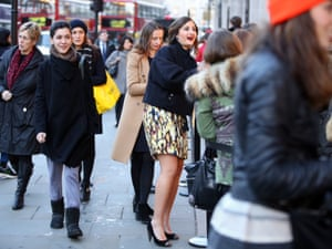 H&Mplog Customers queue ahead of the Isabel Marant collection going on sale at H&M regent st