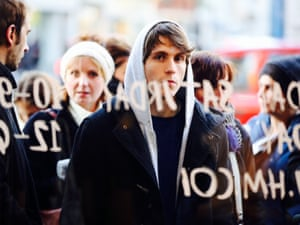 Shoppers queue for the Isabel Murant collection on sale at H&M in Regent Street