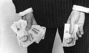 Businessman holidng money