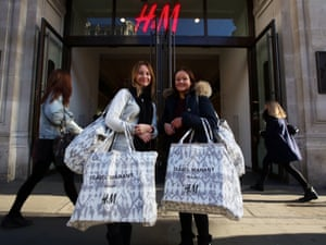 Maria Atkinson (L) and Polly Atkinson (R) leave the Isabel Murant sale at H&M in Regent Street